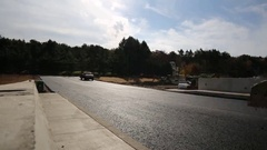 Time Lapse of Steam Roller Flattening Blacktop on Newly-paved Road Stock Footage
