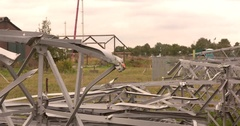 Twisted framework of a removed lattice tower Stock Footage