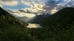 4K. Sunset on an alpine lake Ritsa spring. Abkhazia, Ultra HD. Stock Footage