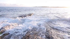 Slow Motion Waves on Rocky Shore Stock Footage