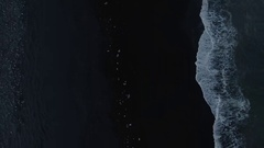 Small Pieces Of Ice On Shore At Black Sand Beach Stock Footage