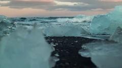 Ocean Waves And Icebergs On Black Volcanic Sand Beach Stock Footage
