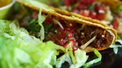 Hard shells beef taco with salsa sauce. Popular Mexican food Stock Footage