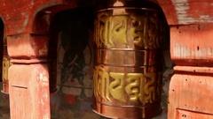 Bhutan prayer bells in wooden monastery turning copper bell closeup Stock Footage