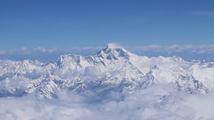 Mount Everest and himalaya panorama view from a plane with all surrounding peaks Stock Footage