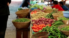 Bhutan local market with vegetables and fruits people selling their harvest Stock Footage