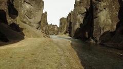 River Flowing Amidst Rock Formations At Fjadrargljufur Stock Footage