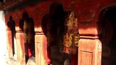 Bhutan prayer bells in wooden monastery turning copper bell Stock Footage