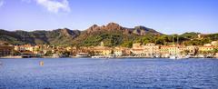 Elba island, Porto Azzurro village bay panoramic view. Tuscany, Italy. Stock Photos