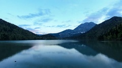 4K. Sunset on an alpine lake Ritsa spring. Abkhazia, Ultra HD Stock Footage