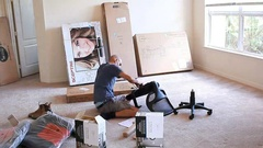 Family unpacking their belongings after moving to new home Stock Footage