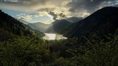 4K. Sunset on an alpine lake Ritsa spring. Abkhazia, Ultra HD.  Stock Footage
