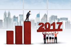 Workers trying to build graph with 2017 Stock Photos