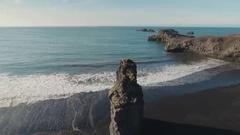 Beautiful Reynisfjara Beach With Long Basalt Sea Stack Stock Footage