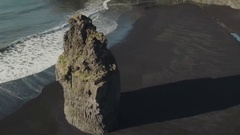 Long Basalt Sea Stack At Reynisfjara Beach Stock Footage