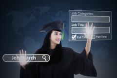 Female bachelor finding jobs online Stock Photos