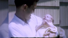 Proud Father Holds New BABY Boy 1960s Vintage Film Home Movie 10434 Stock Footage