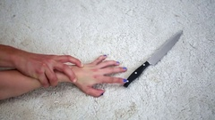 Closeup of hand of woman struggling with man and a knife Stock Footage