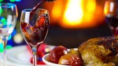 Wine pouring to glass on christmas table in front of fireplace Stock Footage