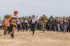 Sportsmen run on last stage in extrim race.Tyumen Stock Photos