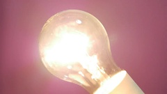 Focus in and Light bulb turns on-off slowly Stock Footage