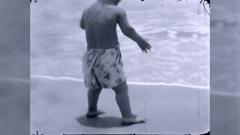 Boy Dwarf Midget Child Runs Beach Summer 1940s Vintage Film Home Movie  Stock Footage