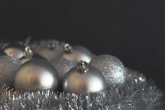 Vintage low contrast photo of shiny and bright silver christmas balls Stock Photos