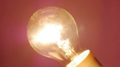 Light bulb turns on and off slowly. Dimming filament incandescent lamp Stock Footage