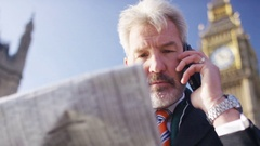 4K Senior business man talking to his broker about share prices, in slow motion Stock Footage