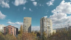 Sunny timelapse at a district with tall apartments building Stock Footage