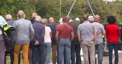 Spectators looking at hoisting activities, shot taken from behind Stock Footage
