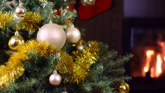 Decorated christmas tree with lights in front of fireplace Stock Footage