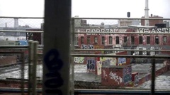 Graffiti On Buildings View From B Train Crossing Manhattan Bridge Brooklyn NYC Stock Footage