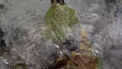 Bubble flow of water in slow motion. Autumn mood Stock Footage