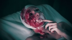 4k Hospital Shot of Injured Woman Putting Oxygen Mask on, colour corrected Stock Footage
