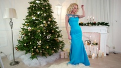 New Year's Eve, party, pretty girl in festive dress is dancing near the Stock Footage