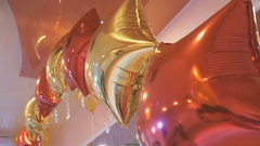 Bright colourful balloons in the shape of stars Stock Footage