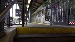 Subway Q Train Leaving Sheepshead Bay Station Brooklyn NYC Stock Footage