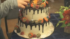 The little boy touches the wedding cake Stock Footage