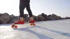 Man in red sneakers skates in park Stock Footage