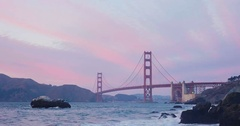 Golden gate bridge by Baker beach with a beautiful sunset Stock Footage