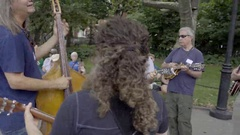 Folk Singers Playing Guitar And Singing Music Washington Square Park Summer NYC Stock Footage