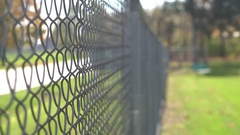 Fence along side of street with focus on linkage 4k Stock Footage
