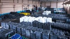 Loader stacks polypropylene bag  in a big stock. 4k timelapse. Stock Footage