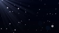 Falling snowflakes through the magical light Stock Footage