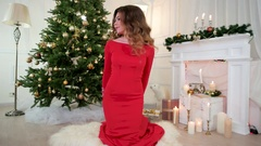 Christmas holiday, the girl playfully looks at the camera holds in hands a gift Stock Footage