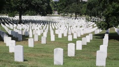 Headstones and graves at the Arlington National Cemetery, panning Stock Footage