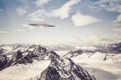 UFO over Alaskan Mountains Stock Photos