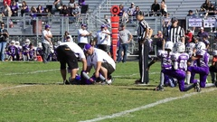Injured football player down on field after hard hit in youth football game 3762 Stock Footage