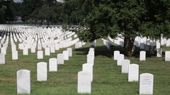 Headstones and graves at the Arlington National Cemetery. panning Stock Footage